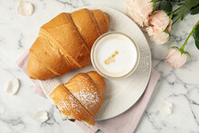 Flat Lay Composition With Tasty Croissants, Latte And Roses On White Marble Table