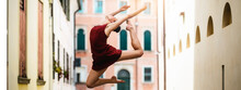 Ballet Dancer Jumps Through The Streets Of The City.
