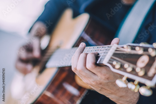 Canvas Close up hand playing guitar