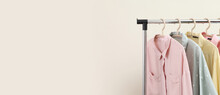 Pastel Shirts Hanging On Rack In Shop And Freespace For Text
