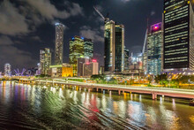 Colourful Lights From A City Skyline Reflected In A River