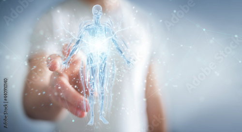Foto Man using digital x-ray human body holographic scan projection 3D rendering