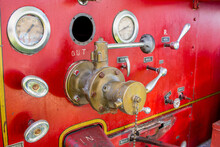 Closeup Of An Old Red Fire Truck With Switches And Indicators