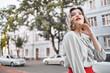 Leinwandbild Motiv attractive woman posing outdoors fashion lifestyle