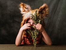 CHILD DRESSED FOX IN A STUDIO PHOTOGRAPH