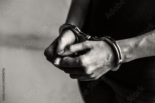 Tela Criminal in handcuffs