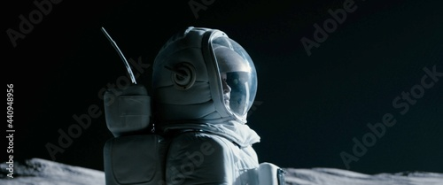 Fotografia Portrait of Asian lunar astronaut opens his visor while exploring Moon surface