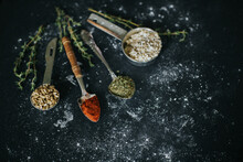 Assorted Spices And Seeds On Black Table