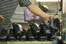 Man's Hands In Quality Control Production Line In Chinese Shoes