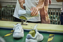 Worker Doing His Task In Shoes Production Line In Chinese Shoes