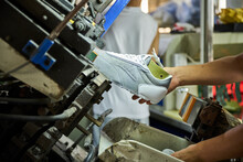 Shoes In Assembling Process In Chinese Factory