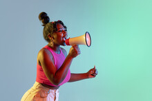 Young Beautiful Happy African Girl Isolated On Blue-green Background In Neon.