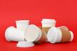 Leinwandbild Motiv Takeaway cups for coffee on color background