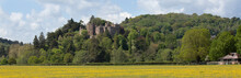 A View Of Dunster Castle In Summerset From The Roadside