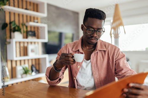 Murais de parede Adult man, drinking his coffee, while thinking.