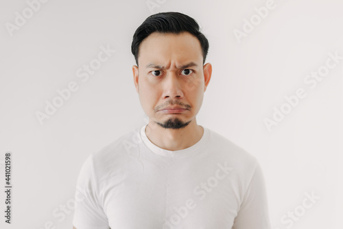 Fototapeta Grumpy face Asian man in white t-shirt isolated on white background