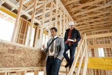Male Homebuilder And Architect At Home Construction Site