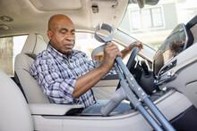 Mature Man Reaching For Forearm Crutches In Car