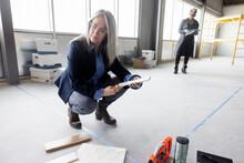 Businesswomen Planning Empty Office Space