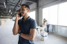 Young Entrepreneur On Phone In New Office Space