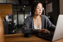 Focused Businesswoman Working At Laptop