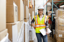 Portrait Confident Female Warehouse Worker With Clipboard