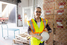 Portrait Confident Female Warehouse Worker At Loading Dock