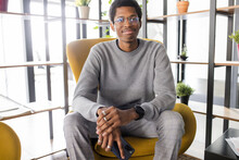 Portrait Confident Handsome Young Businessman In Armchair