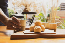 """Brazilian Organic Artisanal Bakery Serving Breakfast With A Coffee Mug And Delicious Cheese Bread """"pão De Queijo"""". Natural Decoration Out Of Focus On The Background. Small Business Concept."""