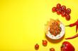 Leinwandbild Motiv Bowl with tasty chili con carne, rice, nachos and vegetables on color background