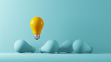 Light Bulb Yellow Floating Outstanding Among Lightbulb Light Blue On Background. Concept Of Creative Idea And Innovation, Think Different, Individual And Standing Out From The Crowd. 3d Illustration