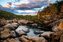 Rocky River And Waterhole At Sunset