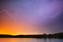 Sunset Lightning Over Lake In Northern Territory