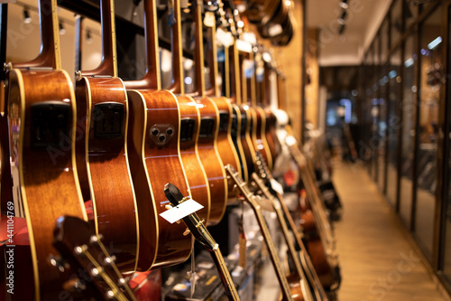 Music shop interior and large collection of classic acoustics guitars for sale Fotobehang