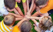 Children Are Playing With Their Hands Clasped Together. Selective Focus.