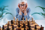 Senior Woman Playing Chess. Cognitive Rehabilitation Therapy.