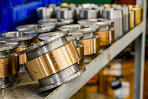 Fotografie, Obraz Hydraulic piston and cylinder on a rack in a warehouse.