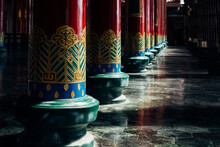 Beautiful Painted Red Pillars On The Green Foundation Stone Of A Chinese Temple