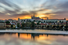 The Famous Prague Castle With The Charles Bridge During A Beautiful Sunset.