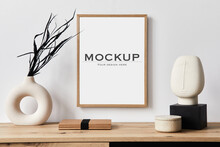 Stylish Interior Of Living Room With Mock Up Poster Frame, Wooden Commode, Book, Black Leaf In Ceramic Vase And Elegant Personal Accessories. Minimalist Concept Of Home Decor. Template.