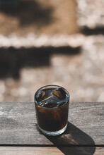 Close-up Of Iced Black Coffee Drink On Table