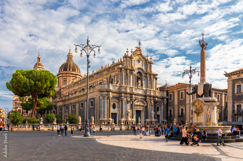 Piazza del Duomo in Catania on a summer day, with Duomo of Saint Agatha and the Elephant Fountain. Sicily, southern Italy. View of Cathedral Sant Agata on Piazza del Duomo in Catania, Sicily, Italy.