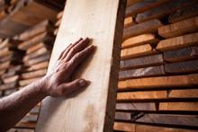 High Angle View Of Human Hand On Wood