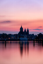 Buildings At Waterfront During Sunset In Amsterdam City