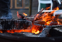 Close-up Of Firewood On Barbecue Grill