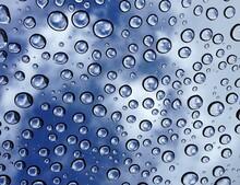 Full Frame Shot Of Wet Glass Against Blue Sky