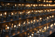Row Of Illuminated Candles In Building
