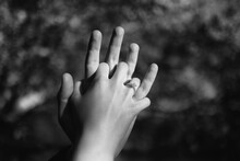Close-up Of Woman Holding Man's Hand Over Blurred Background