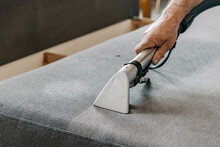 Close-up Image Of Professional Cleaning Service Doing A Deep Clean Of Sofa In Living Room.