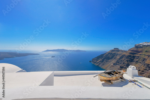 Wallpaper Mural Stunning cupolas with the Caldera (volcano) in the distance in the Greek island